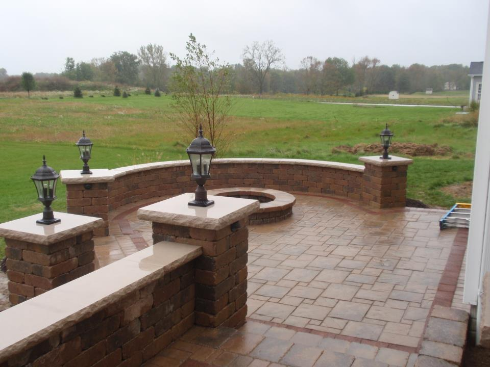 Because Of The Elevation 2 Levels Were Used. A Unilock Firepit Was Built As  You Can See. If You Would Like A Quote On A Pergola Please Contact Me!