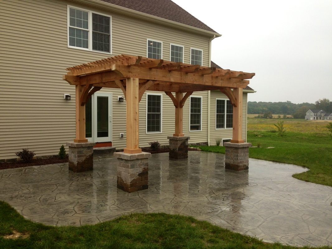Cedar Pergola And Stamped Concrete Installation